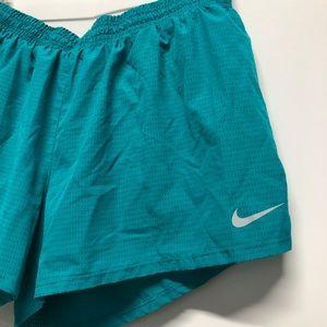 Nike athletic shorts hole design running loose B2